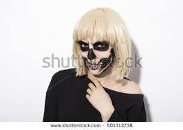 portrait woman terrifying halloween makeup purple stock photo