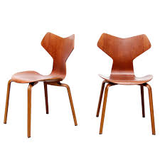 set of two early teak arne jacobsen grand prix dining chairs 3130