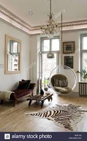 eero aarnio bubble chair in living room with zebra skin rug and