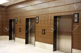 Wooden Panelling by Modern Elevators With Metal Doors Wood Panelling Stock Photo