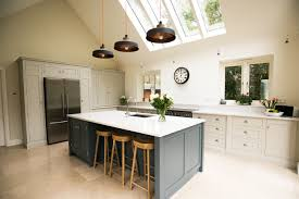 beautiful shaker kitchen with a large island from the white kitchen