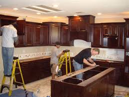 installing kitchen cabinets youtube how to install kitchen cabinets youtube medium size of to install