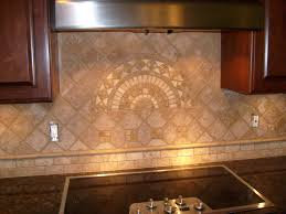 cream back splash with fan shape on the middle combined with brown