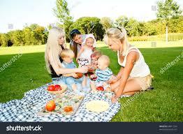 mothers kids having picnic backyard stock photo 68811334