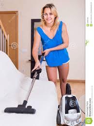 vacuuming furniture at home stock photo image 64967820