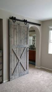 Sliding Barn Doors A Practical Solution For Large Or by Barn Door Over Arched Opening For The Home Pinterest Barn