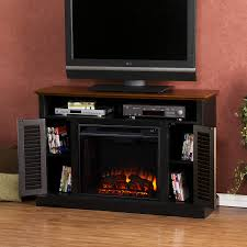 small black oak wood fireplace tv stand with shutter doors of