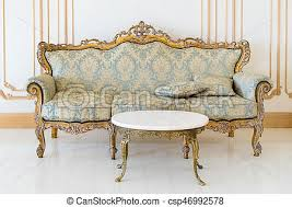 picture of luxury livingroom in light colors with golden furniture