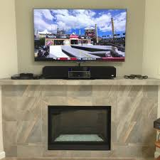 decoration fantastic mounting a tv over a fireplace and tile