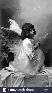 child as kneeling and praying postcard early