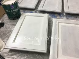 How To Paint My Kitchen Cabinets White Keeping It Simple Tips On How To Paint Dark Veneer Cabinets White