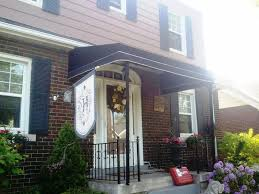 retractable porch awnings jburgh homes best porch awnings for