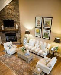 stone corner fireplace design with open shelf and lcd tv and beige
