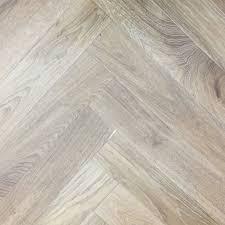 light oak engineered hardwood flooring elka light smoked oak herringbone 14mm engineered wood flooring