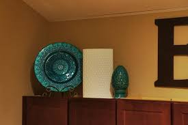 Decorating Above Kitchen Cabinets Pictures by Decorating Above The Kitchen Cabinets Little Lessons In A Big City