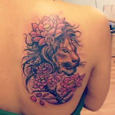 lion with flower tattoo for women on back