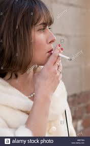 girl pearl necklace images Woman with red lipstick wearing a pearl necklace smoking a stock jpg