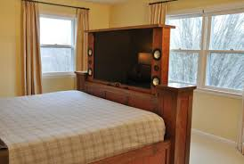 tv lift cabinet foot of bed television in your master bedroom interior design scottsdale az