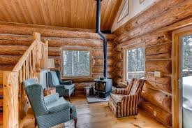 ptarmigan lodge 3 bedrooms plus a loft darling secluded cabin there is a cozy wood stove in the living area with lots of wood in the garage