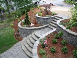 stunning sloping garden landscape designed with grey retaining