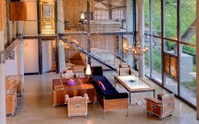 loft apartment design black sofas on the white off rug on the black floor inside modern