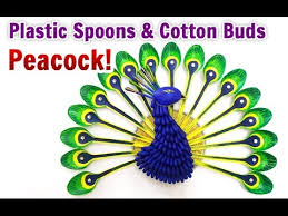 diy home decoration how to make a peacock from plastic spoons