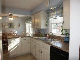 cottage kitchen with limestone tile floors u0026 l shaped in webster