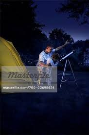 Camping In The Backyard Father And Son Camping In The Backyard At Night Looking Through