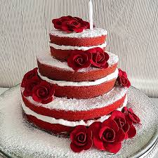 tiered red velvet cake layered with vanilla buttercream and