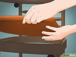 is it safe to use vinegar on wood cabinets 3 ways to clean wood furniture with vinegar wikihow