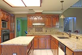 kitchen design with light beige granite countertops and mosaic