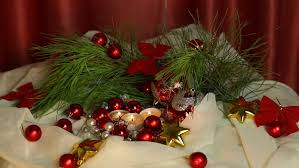 three red christmas candles and colorful ornaments stock footage
