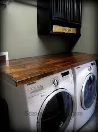 Laundry Room Storage Between Washer And Dryer by Wood Countertop Diy Scavenger Chic