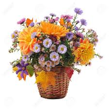 bouquet of autumn flowers in basket isolated on white stock photo