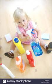 House Cleaning by 18 Month Old Baby Playing With House Cleaning Products Stock