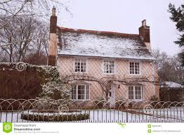 english country cottage in the winter snow stock photo image