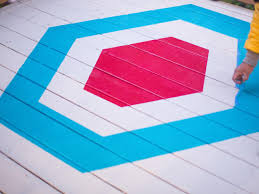 how to stencil a geometric pattern on a deck hgtv adding pattern to deck with blue painter s tape