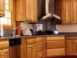 double built in oven hanging range hood oak wood kitchen storage