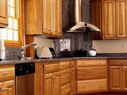 Kitchen Backsplash For Black Granite Countertops - wall mounted range hood white gas range light blue glass kitchen