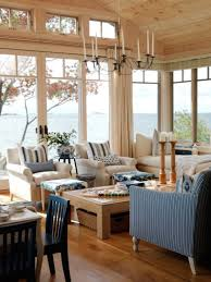 mary emmerlings beach cottages at home by the sea coastal style best coastal living room decorating ideas sunroom cottage style showing creamy fabric club chair sofa using