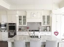 white kitchen cabinets with quartz countertops white kitchen with grey subway tile backsplash and shaker