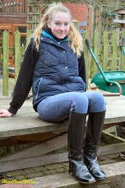 dirty riding boots having a sit down in her horse riding clothes new equestri