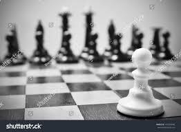 single pawn against many enemies symbol stock photo 147259046