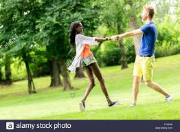 Beautiful Outdoors beautiful couple dancing outdoors in a park displaying joy and