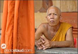tattooed buddhist monk in bakong temple angkor cambodia