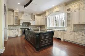 pictures of off white kitchen cabinets off white kitchen cabinets with dark island kutskokitchen