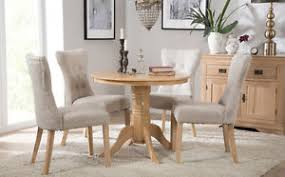 kingston dining room table kingston round oak dining room table and 4 bewley fabric chairs set