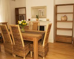 formal dining with teak table and woven chairs your guests will