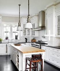 black butcher block kitchen island michael robinson photography crisp white kitchen design with white