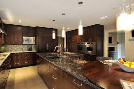 calm contemporary kitchen with dark quarts counter also table top